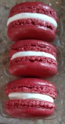 Red velvet macaron shells filled with cream cheese filling